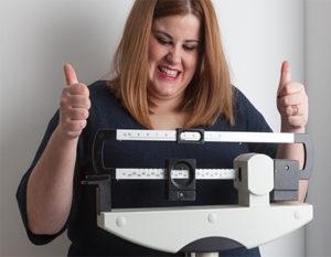 woman-happy-at-weight-loss