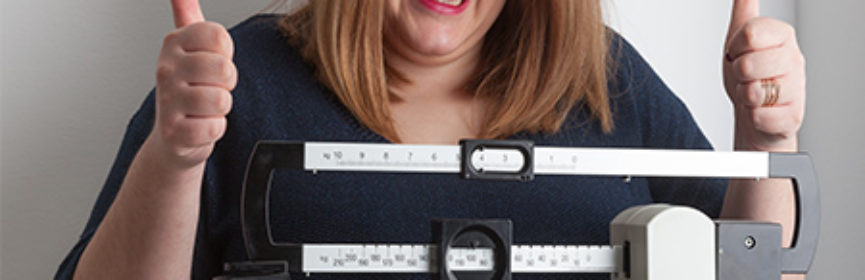 woman-happy-at-weight-loss