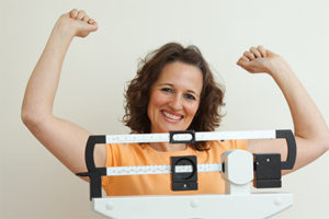 woman-happy-with-her-weight-loss
